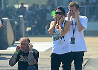 Sept. 23, 2012; Ennis, TX, USA: NHRA funny car driver Alexis DeJoria (right) with television personality Jesse James during the Fall Nationals at the Texas Motorplex. Mandatory Credit: Mark J. Rebilas-US PRESSWIRE