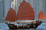 CHINESE JUNK IN VICTORIA HARBOR AGAINST SKYLINE