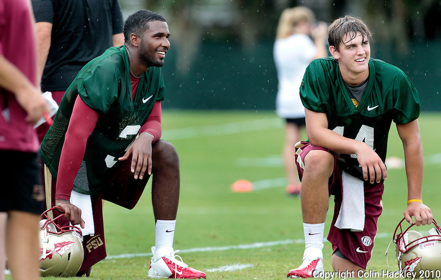 TALLAHASSEE, FL 8/7/12-FSU080712 CH-Florida State's EJ Manuel and Jacob Coker take a break during practice Aug. 7 in Tallahassee. .COLIN HACKLEY PHOTO