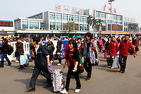 Migrant workers return to Guangzhou train station.  mMillions of Chinese migrant workers return to Guangzhou after Chinese New Year to look for work. This year their prospects look bleak for finding work..05 Feb 2009