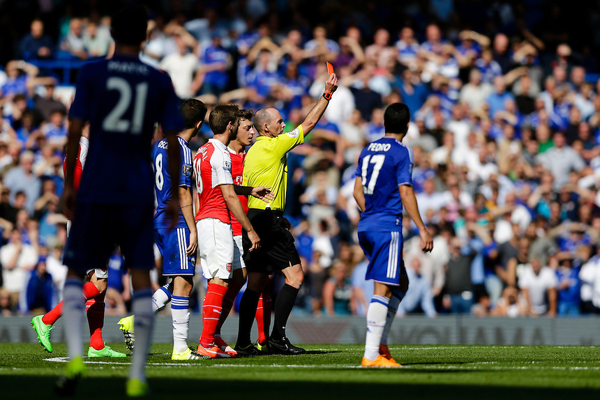 Referee Mike Dean shows a red card to Arsenal's Gabriel Paulista (not pictured)<br /> <br /> Photographer Craig Mercer/CameraSport<br /> <br /> Football - Barclays Premiership - Chelsea v Arsenal - Saturday 19th September 2015 - Stamford Bridge - London<br /> <br /> &copy; CameraSport - 43 Linden Ave. Countesthorpe. Leicester. England. LE8 5PG - Tel: +44 (0) 116 277 4147 - admin@camerasport.com - www.camerasport.com