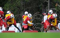 Jul 31, 2009; Flagstaff, AZ, USA; Arizona Cardinals defensive players do pad drills during training camp on the campus of Northern Arizona University. Mandatory Credit: Mark J. Rebilas-