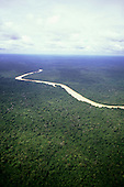 Rio Branco, Brazil. Aerial view of river twisting through unbroken rainforest. Roraima State, Amazon.