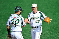Pitcher Austin Wynn (45) of the Charlotte 49ers, right, embraces catcher Nick Daddio (20) after closing out Game 1 of a doubleheader against the Fairfield Stags on Saturday, March 12, 2016, at Hayes Stadium in Charlotte, North Carolina. (Tom Priddy/Four Seam Images)