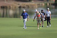 Lee Westwood (ENG) and Thomas Detry (BEL) on the 18th fairway during the 2nd round of the DP World Tour Championship, Jumeirah Golf Estates, Dubai, United Arab Emirates. 16/11/2018<br /> Picture: Golffile | Fran Caffrey<br /> <br /> <br /> All photo usage must carry mandatory copyright credit (© Golffile | Fran Caffrey)