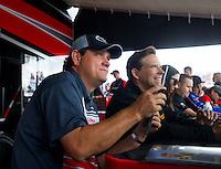 Jun 6, 2015; Englishtown, NJ, USA; NHRA funny car driver Chad Head (left) and Del Worsham during qualifying for the Summernationals at Old Bridge Township Raceway Park. Mandatory Credit: Mark J. Rebilas-