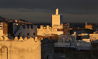 Rooftops catching the last rays of sunlight in the medina or old town of Tetouan on the slopes of Jbel Dersa in the Rif Mountains of Northern Morocco. Tetouan was of particular importance in the Islamic period from the 8th century, when it served as the main point of contact between Morocco and Andalusia. After the Reconquest, the town was rebuilt by Andalusian refugees who had been expelled by the Spanish. The medina of Tetouan dates to the 16th century and was declared a UNESCO World Heritage Site in 1997. Picture by Manuel Cohen