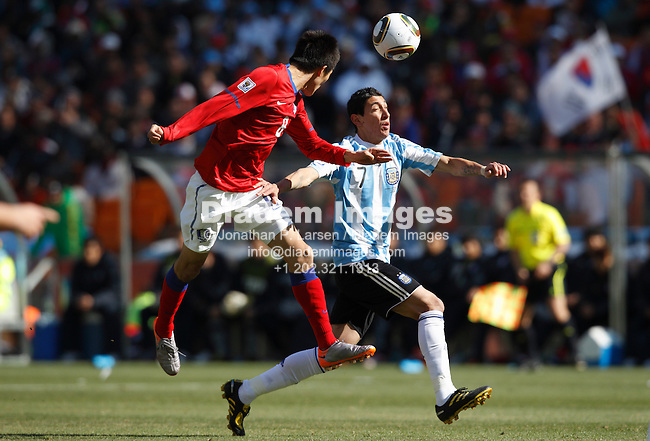 JOHANNESBURG - JUNE 17:  Jung Woo Kim of South Korea (8) heads the ball against Angel Di Maria of Argentina (7) during a  2010 FIFA World Cup soccer match June 17, 2010 in Johannesburg, South Africa.  NO mobile use.  Editorial ONLY.  (Photograph by Jonathan P. Larsen)