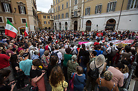 "Rome, 15/07/2019. Today, Rete Restiamo Umani - supported by several other organizations – held a demo outside the Italian Parliament, in Piazza Montecitorio, against the Decreto Sicurezza Bis (Decree Law n. 53, 14 June 2019, http://bit.do/eV3iZ) which was supposed to be discussed in the Parliament from today, which instead was postponed to the 22nd of July 2019. The rally saw protesters, activists and members of the public protesting, but also debating to find ideas and proposals, and how to continue the protests against the ""controversial"" decisions and policies of the coalition Government (League – Five Star Movement, http://bit.do/eZ562 )'s Interior Minister Matteo Salvini (League / Lega, http://bit.do/eE7Ey ). The so-called ""Decreti Salvini / Decreto Sicurezza / Decreto Sicurezza Bis"" (The first Decree is now Law of the Italian Republic, Legge 1° Dicembre 2018, n. 132, http://bit.do/eE7uo), made by the Interior Minister Matteo Salvini, are accused by protesters to be racist and strictly restrictive of civil liberties, including the right to protest. Moreover, the protest was in support and solidarity with people living in the housing occupation of Rome's Via Cardinal Capranica (300+ People including 80 minors), the abandoned school which was evicted during the night by the police. The demo was also against the decision of Salvini to keep closed the Italian ports to NGO vessels, and the strict new rules and fines about ""saving migrants in the Mediterranean"" contained in the Decreto Sicurezza Bis. People gathered outside Parliament also due to show that Italy is still an antifascist, anti-racist and welcoming Country and that its people are still aware and supporting International Laws which impose to rescue people when they are in need.<br />