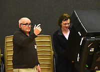 NWA Democrat-Gazette/FLIP PUTTHOFF <br /> Joe Terrick, poll worker, ushers voters to voting machines Tuesday March 12 2019 during the sales tax election. Debbie Dillier (cq) (right) of Bentonville votes at Bentonville Church of Christ.