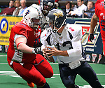 SIOUX FALLS, SD - MARCH 17:  Corey Johnsen #96 from the Sioux Falls Storm chases down quarterback Barney O'Donnell III #13 from the Wyoming Calvary in the first quarter of their game Sunday afternoon at the Sioux Falls Arena. (Photo by Dave Eggen/Inertia)