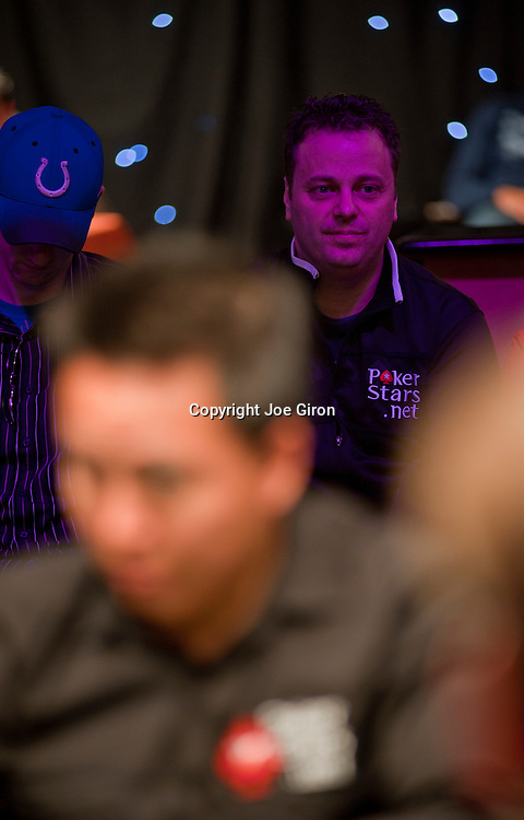 Team Pokerstars Pro Pat Pezzin, background, rails fellow team pro and Canadian, Anh Van Nguyen, foreground, at today's final table.