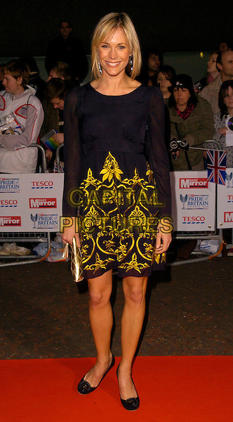 JENNI FALCONER.The Daily Mirror's Pride Of Britain Awards, London Television Studios, London, UK..November 6th, 2006.Ref: CAN.full length black yellow pattern dress.www.capitalpictures.com.sales@capitalpictures.com.©Can Nguyen/Capital Pictures