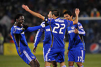 Kansas City Wizards players celebrate Davy Arnaud's goal...Kansas City Wizards defeated DC United 4-0 in their season opener, at Community America Ballpark in Kansas City, Kansas.