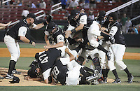 June 20, 2009: Greenville Drive players celebrate winning the first half Southern Division title for the South Atlantic League Saturday night with a 15-3 win over the Lexington Legends at Fluor Field at the West End in Greenville, S.C. Drive players were wearing Greenville Mill League throwback jerseys that were being auctioned off after the game. Photo by: Tom Priddy/Four Seam Images