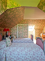 An attic bedroom is a celebration of toile de Jouy with wallpaper by F. Schumacher