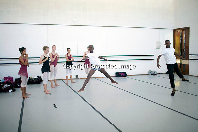 CAPE TOWN, SOUTH AFRICA - MARCH 6: Sikhumbuzo Hlahleni (left), age 15, trains jumps with other students at Cape Town City Ballet's youth company on March 6, 2010 in Cape Town, South Africa. He trains in Cape Town every Saturday. He also trains a few days week at home in Khayelitsha, a poor township outside Cape Town. (Photo by Per-Anders Pettersson).