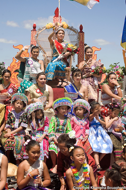 Miss Songkran Tisha Phengdara and her court lead head a parade celebrating the Lao New Year at Wat Lao Thepnimith in Fort Worth on April 25, 2010.  (photo by Khampha Bouaphanh)