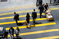HONG KONG - APRIL 14: People cross the street in Central business district, on April 14, in Hong Kong. (Photo by Lucas Schifres/Pictobank)