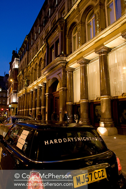 A car parked outside the Hard Days Night Hotel which is situated on the corner of Matthew Street and Great John Street in the 'Beatles Quarter' of Liverpool. The Beatles-themed hotel was opened in 2008, with the exterior featuring statues of the Fab Four. Liverpool was 2008 European Capital of Culture.