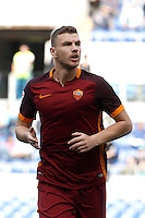 Calcio, Serie A: Lazio vs Roma. Roma, stadio Olimpico, 3 aprile 2016.<br /> Roma's Edin Dzeko celebrates after scoring during the Italian Serie A football match between Lazio and Roma at Rome's Olympic stadium, 3 April 2016.<br /> UPDATE IMAGES PRESS/Isabella Bonotto
