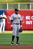Tony Abreu (6) of the Fresno Grizzlies on defense against the Salt Lake Bees at Smith's Ballpark on April 9, 2014 in Salt Lake City, Utah.  (Stephen Smith/Four Seam Images)