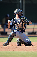 Milwaukee Brewers catcher Jack Cleary (23) warms up the pitcher in between innings during an Instructional League game against the Los Angeles Angels on October 11, 2013 at Tempe Diablo Stadium Complex in Tempe, Arizona.  (Mike Janes/Four Seam Images)