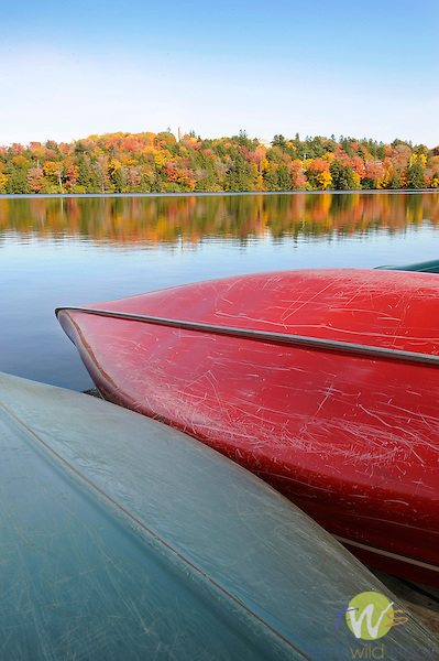 Eagles Mere Lake in autumn with canoes.