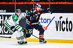 Stockholm 2014-03-27 Ishockey Kvalserien Djurg&aring;rdens IF - R&ouml;gle BK :  <br /> Djurg&aring;rdens Henrik Eriksson i kamp om bollen med R&ouml;gles Erik Thorell <br /> (Foto: Kenta J&ouml;nsson) Nyckelord:  DIF Djurg&aring;rden R&ouml;gle RBK Hovet