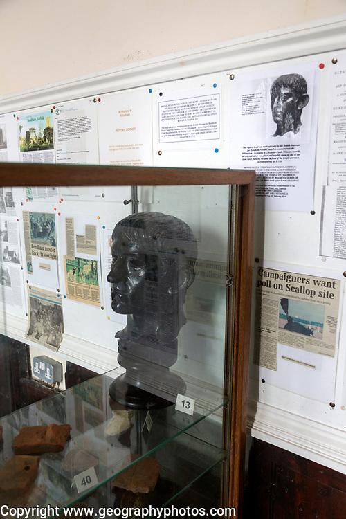 Replica head of Roman Emperor Claudius in glass church museum display cabinet, Rendham, Suffolk, England, UK