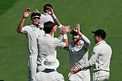 22nd March 2018, Eden Park, Auckland, New Zealand; International Test Cricket, New Zealand versus England, day 1;  Tim Southee (L) and Kane Williamson (R) celebrate the wicket of Dawid Malan with Trent Boult