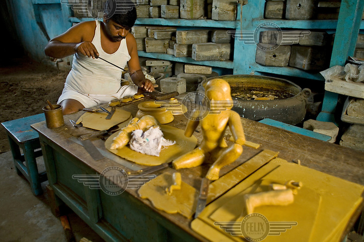 A craftsman carves an icon from wax in the S. Devasenapathy Sthapathy and Sons bronze casting workshop. The current Sthapathy generation is the twenty-third generation of bronze casters. Their method using the lost-wax process remains unchanged to this day.