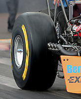 Feb 20, 2015; Chandler, AZ, USA; Detailed view of the rear Goodyear tire of NHRA top fuel driver Clay Millican as he does a burnout during qualifying for the Carquest Nationals at Wild Horse Pass Motorsports Park. Mandatory Credit: Mark J. Rebilas-