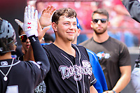 Lansing Lugnuts outfielder Ryan Noda (19) high-fives teammates in the dugout during a Midwest League game against the Wisconsin Timber Rattlers on May 8, 2018 at Fox Cities Stadium in Appleton, Wisconsin. Lansing defeated Wisconsin 11-4. (Brad Krause/Four Seam Images)