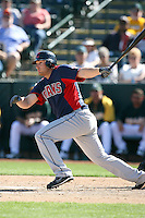 Chad Huffman of the Cleveland Indians bats against the Oakland Athletics in a spring training game at Phoenix Municipal Stadium on March 2, 2011  in Phoenix, Arizona. .Photo by:  Bill Mitchell/Four Seam Images.
