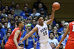 15 November 2014: Duke's Jahlil Okafor (15) and Fairfield's Malcolm Gilbert (left). The Duke University Blue Devils hosted the Fairfield University Stags at Cameron Indoor Stadium in Durham, North Carolina in an NCAA Men's Basketball exhibition game. Duke won the game 109-59.