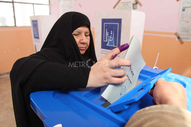 NAJAF, IRAQ: A woman votes in Najaf...On March 7th, 2010, Iraq held nationwide parliamentary elections.