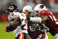 Oct. 16, 2006; Glendale, AZ, USA; Chicago Bears running back (20) Thomas Jones rushes the ball against the Arizona Cardinals at University of Phoenix Stadium in Glendale, AZ. Mandatory Credit: Mark J. Rebilas