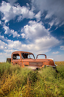 An old Ford farmtruck abandoned in a field in western Kansas.