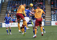 Lee Kilday gets to the ball first under pressure from Charles Dunne in the SPFL Betfred League Cup group match between Queen of the South and Motherwell at Palmerston Park, Dumfries on 13.7.19.
