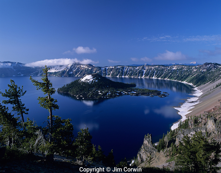 Crater Lake National Park Klamath County sunrise with Wizard Island and west rim Crater Lake Central Oregon State USA