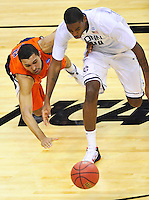 Bryson Johnson of Bucknell and Roscoe Smith of the Huskies go after the loose ball. Connecticut defeated Bucknell 81-52 during the NCAA tournament at the Verizon Center in Washington, D.C. on Thursday, March 17, 2011. Alan P. Santos/DC Sports Box