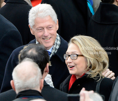 Former United States President Bill Clinton and Secretary of State Hillary Rodham Clinton greet guests as they arrive to witness U.S. President Barack Obama take the oath of office during the public swearing-in ceremony at the U.S. Capitol in Washington, D.C. on Monday, January 21, 2013..Credit: Ron Sachs / CNP.(RESTRICTION: NO New York or New Jersey Newspapers or newspapers within a 75 mile radius of New York City)