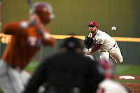NWA Democrat-Gazette/J.T. WAMPLER  Arkansas' Kacey Murphy sends in a pitch against Texas' Mason Hibbeler Tuesday March 13, 2018 at Baum Stadium in Fayetteville.
