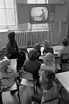 Primary school children watching  schools TV 1970s London.