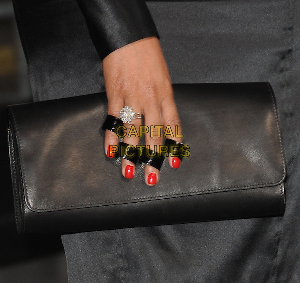 "TARAJI P. HENSON's bag .at Alcon Entertainment's L.A. Premiere of ""The Book of Eli"" held at The Chinese Theatre in Hollywood, California, USA,  January 11th 2010..detail hand red nails nail varnish polish ring holders rings clutch .CAP/RKE/DVS.©DVS/RockinExposures/Capital Pictures."