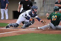 Cedar Rapids Kernels catcher Ben Rortvedt (9) prepares to put the tag on Nate Mondou (10) of the Beloit Snappers as he tries to score a run in the top of the 1st inning at Veterans Memorial Stadium on April 8, 2017 in Cedar Rapids, Iowa.  The Snappers defeated the Kernels 7-6.  (Dennis Hubbard/Four Seam Images)