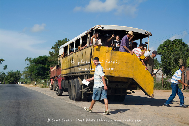 Passengers disembarking from a truck used for public transport outside Pinar del Rio, Cuba.