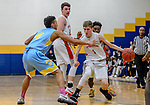 WATERBURY, CT. 14 March 2018-031418BS675 - Benjamin North (11) from Northwestern drives past Kyle Federici (4) from Kolbe Cathedral (4) in their Div IV semi-finals at Kennedy High School on Wednesday afternoon. Kolbe went on to defeat Northwestern and advanced to the finals at Mohegan Sun. Bill Shettle Republican-American