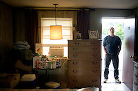 "Joel Dubeshter, 58, has lived at Motel Caswell ""on and off for 3 years,"" seen here at the motel in Tewksbury, Massachusetts, USA, on Tuesday, Oct. 11, 2011. Dubeshter says, ""This [place] is a stepping stone."" His mail is delivered to the motel and he's moved in some of his own furniture, including a walnut dresser previously owned by his parents, and keeps the room clean on his own instead of relying on the motel's maids. Dubeshter previously worked for the Boston Globe in the mail room where he served as union chairman for a time, but the job took its toll after nearly 30 years, creating back problems that led to him having to quit the job. He lost his house in a divorce and began living at the motel. ..The motel is owned by Russell Caswell. Caswell's father built the motel in the 1950s. Now, conservative activitists are trying to use federal asset-forfeiture laws to seize the motel, saying that the motel is used by drug dealers to conduct business.  The legal challenge intends to show evidence tying the property to crimes in order to seize the motel.....CREDIT: M. Scott Brauer for the Wall Street Journal.slug: FORFEIT..CREDIT: M. Scott Brauer for the Wall Street Journal."
